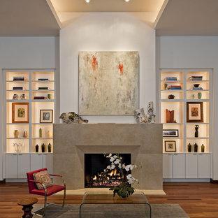 Idées déco pour un salon contemporain avec un mur blanc et une cheminée standard.