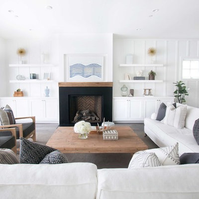 Living room - coastal dark wood floor living room idea in Orange County with white walls and a standard fireplace