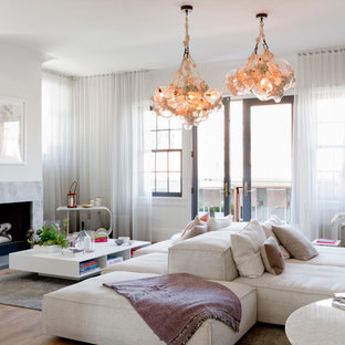 Example of a trendy formal light wood floor living room design in New York with a standard fireplace