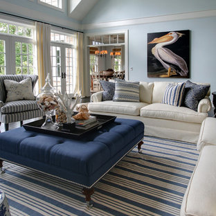 Large beach style enclosed living room in Portland with blue walls and dark hardwood flooring.