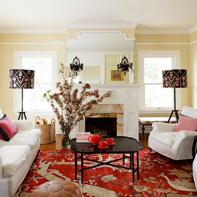 Inspiration for a timeless living room remodel in Portland with beige walls and a standard fireplace