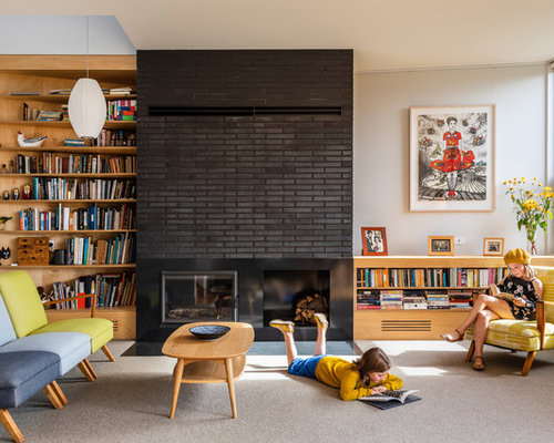 Inspiration For A Midcentury Living Room In Hobart With White Walls,  Carpet, A Standard