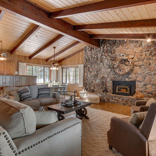 Inspiration for a rustic formal medium tone wood floor and brown floor living room remodel in Sacramento with brown walls, a wood stove and no tv