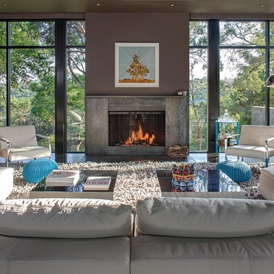 Inspiration for a large contemporary open concept dark wood floor living room remodel in Austin with gray walls, a standard fireplace and a concrete fireplace