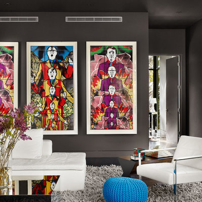 Inspiration for a contemporary living room remodel in Austin with black walls