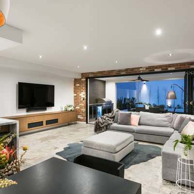 Inspiration for a contemporary open concept gray floor living room remodel in Perth with white walls and a wall-mounted tv