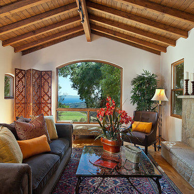 Inspiration for a rustic living room remodel in Santa Barbara with a stone fireplace