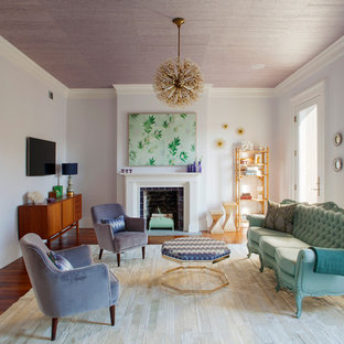 Inspiration for a mid-sized transitional formal and enclosed dark wood floor and brown floor living room remodel in Atlanta with gray walls, a standard fireplace, a tile fireplace and a wall-mounted tv