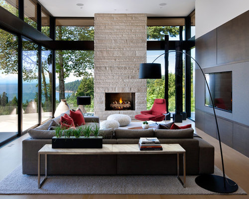 Inspiration For A Modern Living Room Remodel In Vancouver With Media Wall And Beige Floors
