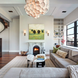 Living room - transitional formal dark wood floor living room idea in New York with beige walls, a standard fireplace and a wall-mounted tv