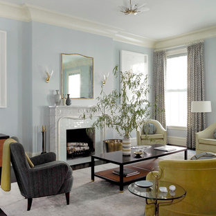 Design ideas for a traditional formal living room in New York with blue walls and a standard fireplace.