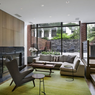 Example of a trendy living room design in New York with a standard fireplace