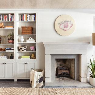 Foto de salón costero, sin televisor, con paredes grises, suelo de madera oscura, estufa de leña y marco de chimenea de piedra