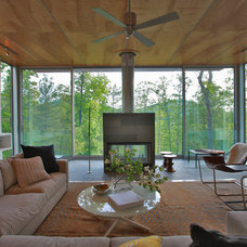 Modern Living Room by Travis Price Architects Inc.