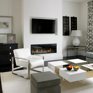 Example of a mid-sized trendy open concept dark wood floor living room design in London with beige walls, a ribbon fireplace and a wall-mounted tv
