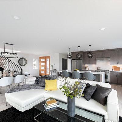 Trendy open concept light wood floor and beige floor living room photo in Los Angeles with white walls