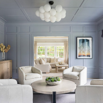 Inspiration for a large timeless formal and enclosed light wood floor and white floor living room remodel in New York with gray walls, no fireplace and no tv