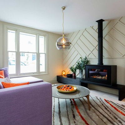 Example of a mid-sized trendy enclosed living room design in London with white walls and a ribbon fireplace