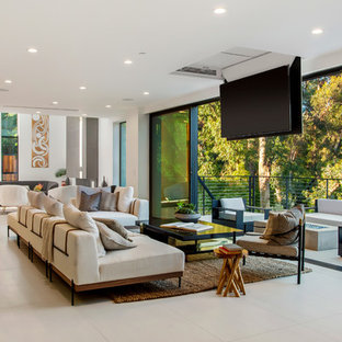 Inspiration for a large contemporary formal and open concept white floor living room remodel in Los Angeles with white walls, no fireplace and a concealed tv
