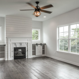Living room - traditional open concept medium tone wood floor, brown floor and shiplap wall living room idea in Louisville with white walls, a standard fireplace and a shiplap fireplace