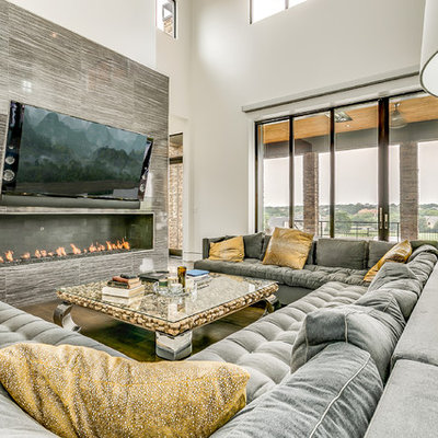 Trendy open concept living room photo in Dallas with gray walls, a wall-mounted tv and a ribbon fireplace