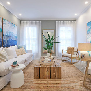 Nautical enclosed living room in Melbourne with grey walls, light hardwood flooring and a corner fireplace.