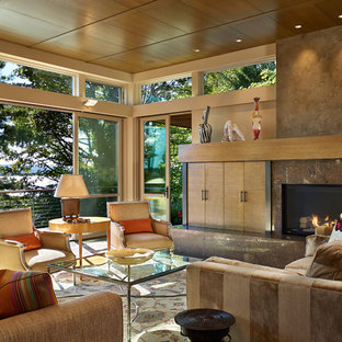 Inspiration for a contemporary living room remodel in Seattle with beige walls and a standard fireplace