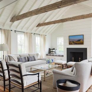 Cette photo montre un salon nature avec un mur blanc.