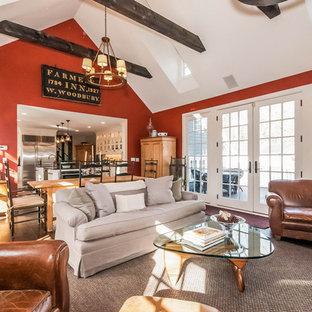 Ispirazione per un grande soggiorno country aperto con pareti rosse, cornice del camino in pietra, TV a parete, parquet scuro e pavimento marrone