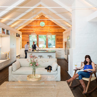 Transitional open concept dark wood floor living room photo in Austin with white walls