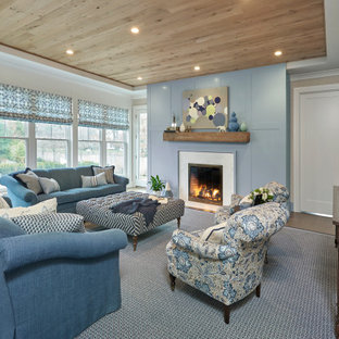 Living room - traditional medium tone wood floor and brown floor living room idea with gray walls and a stone fireplace