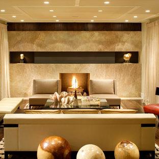 マイアミの大きいコンテンポラリースタイルのおしゃれなLDK (ベージュの壁、標準型暖炉、濃色無垢フローリング) の写真