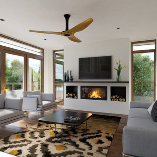 Inspiration for a mid-sized contemporary formal and open concept medium tone wood floor living room remodel in Melbourne with white walls, a wall-mounted tv and a ribbon fireplace