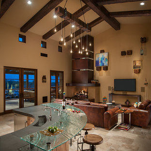 Example of a southwest open concept living room design in Phoenix with a wall-mounted tv