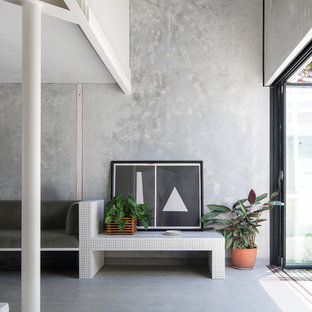 Design ideas for an industrial open concept living room in Perth with grey walls, concrete floors, no fireplace and grey floor.