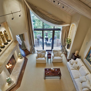 Inspiration for a timeless beige floor living room remodel in Vancouver with beige walls and a standard fireplace