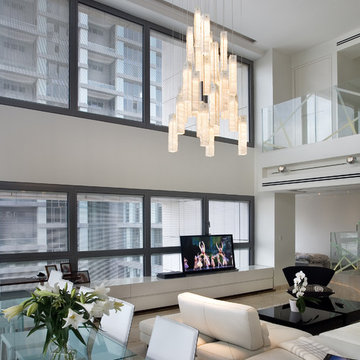 White candles chandelier - by Galilee Lighting - Two story living room chandelie