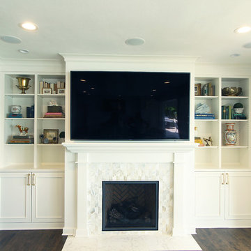 White Fireplace Built-Ins with Geometric Marble Tile