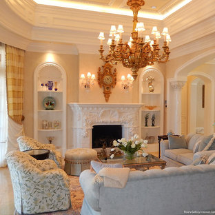 Living room - large mediterranean marble floor living room idea in Miami with beige walls, a two-sided fireplace and a stone fireplace