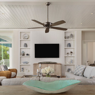 Inspiration for a medium sized world-inspired open plan living room in Miami with white walls, light hardwood flooring, a built-in media unit and brown floors.