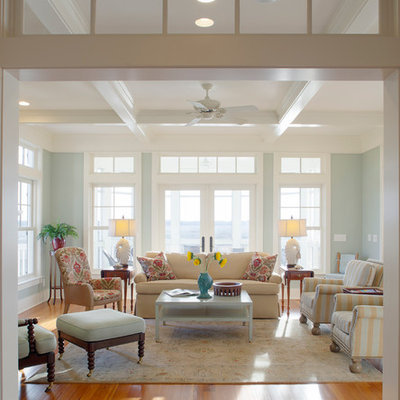 Large beach style formal and enclosed medium tone wood floor living room photo in Charleston with gray walls and no tv