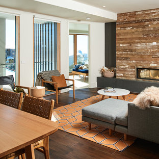 Inspiration for a contemporary formal open concept living room in Melbourne with white walls, dark hardwood floors, a ribbon fireplace, no tv and brown floor.
