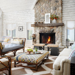 Mountain style living room photo in Milwaukee with a standard fireplace and a stone fireplace