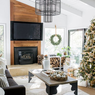 Design ideas for a country living room in Sacramento with white walls, dark hardwood flooring, a wood burning stove, a wall mounted tv and brown floors.