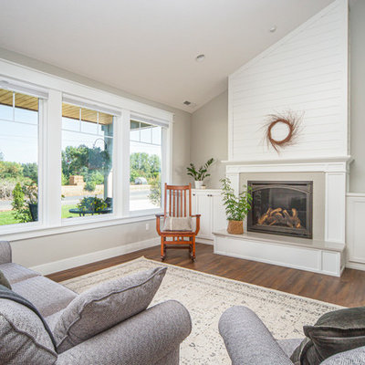 Inspiration for a large transitional open concept medium tone wood floor and brown floor living room remodel in Portland with gray walls, a standard fireplace, a tile fireplace and no tv