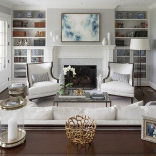 Foto de salón para visitas clásico con paredes grises, suelo de madera oscura, chimenea tradicional, marco de chimenea de baldosas y/o azulejos y suelo marrón