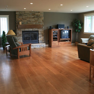 Inspiration for a mid-sized transitional formal and enclosed medium tone wood floor and brown floor living room remodel in Denver with gray walls, a standard fireplace, a stone fireplace and no tv