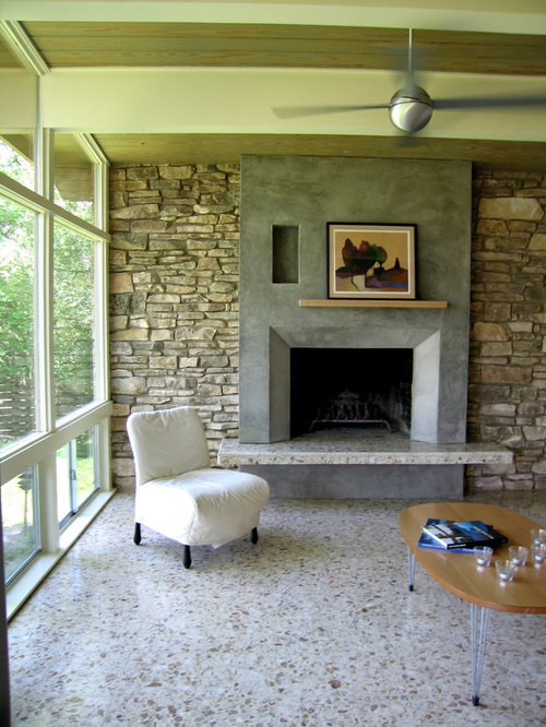 inspiration for a modern living room remodel in austin with a standard fireplace and a concrete