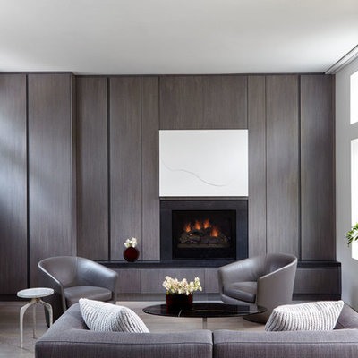 Mid-sized minimalist open concept brown floor and dark wood floor living room photo in New York with white walls, a standard fireplace, a stone fireplace and a concealed tv