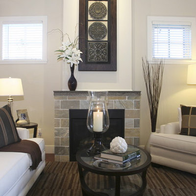 Inspiration for a contemporary living room remodel in Vancouver with a standard fireplace